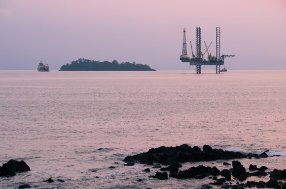 Island and an oil rig